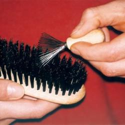 Rastrillo para limpiar cepillos y peines