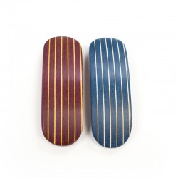 Curved wooden clip with striped design for thick hair.